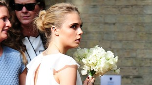 Poppy's sister and fellow model Cara Delevingne also wore white.