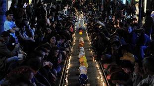 Demonstrators light candles in memory of the mine victims during a sit-in protest in Istanbul.