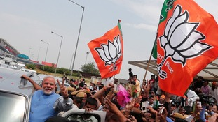 Hindu nationalist Narendra Modi gestures from his car during the parade.