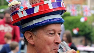 Man with union jack hat