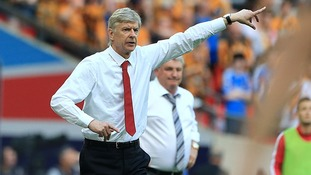 Arsenal manager Arsene Wenger on the touchline as his Hull City counterpart Steve Bruce looks on