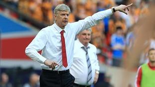 Arsenal manager Arsene Wenger on the touchline as his Hull City counterpart Steve Bruce looks on