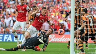 Arsenal's Laurent Koscielny scores his side's second goal to take them into extra time