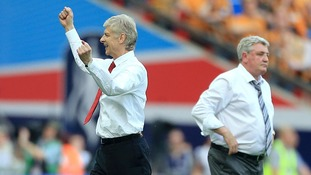 Arsenal manager Arsene Wenger (left) celebrates at the final whistle as Hull City manager Steve Bruce looks on