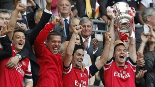 Arsenal's Thomas Vermaelen lifts the FA Cup trophy