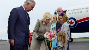 Prince Charles and his wife Camilla receive flowers from Grace Elizabeth and Molly Jane Lenihan.