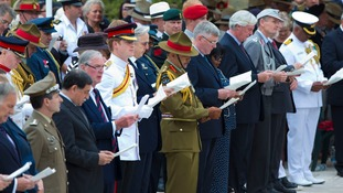 Prince Harry at today's memorial service on the battle's 70th anniversary.