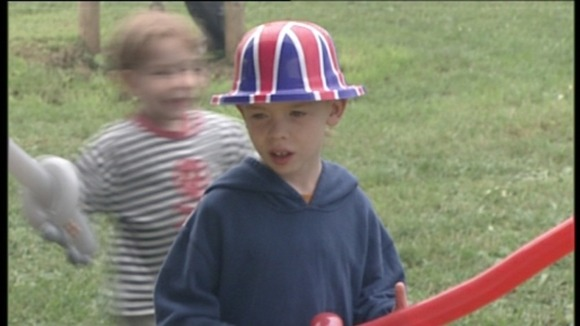 child in union jack bowler