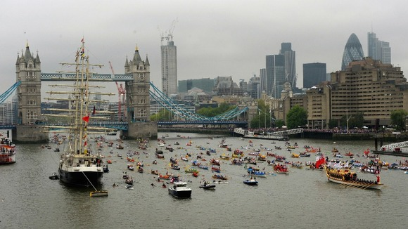 The Gloriana, the £1 million row barge, leads the manpowered section of the Diamond Jubilee River Pageant along the River Thames.