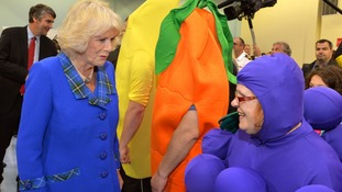 The Duchess of Cornwall meets a volunteer on the second day of the royal tour in Canada