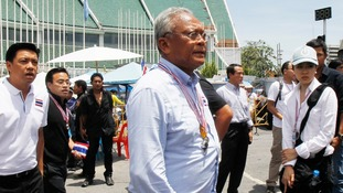 Anti-government protest leader Suthep Thaugsuban walks with other during a rally near the Government House in Bangkok today.