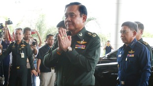 Thai Army chief General Prayuth Chan-ocha arrives to give a news conference at the Army Club in Bangkok today.