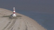 Orfordness lighthouse is under threat from the sea