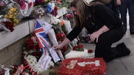Family of Lee Rigby lay tributes at scene of his death