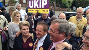 Nigel Farage celebrates with party members.