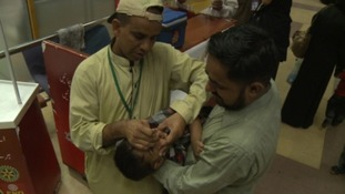 Travelers who cannot prove they have been vaccinated are given polio drops at the airport.