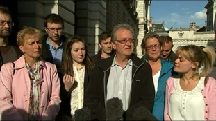 Graham Male speaking outside the Foreign Office after a meeting with officials.