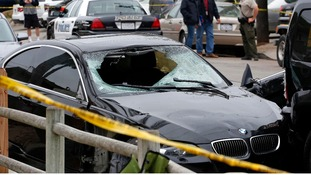 The gunman's black BMW is pictured at one of the crime scenes.