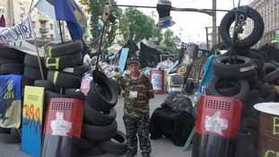 A man next to barricades in Kiev.