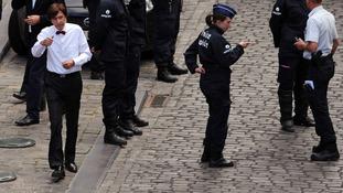 Belgian Prime Minister Elio Di Rupo visits the scene.