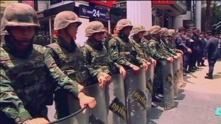 The military line a street in Bangkok as Thai anti-coup protesters rally.