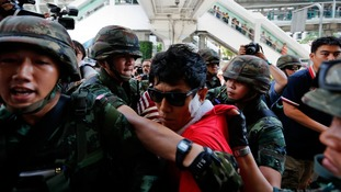 Soldiers detain an activist during the protests in Bangkok.