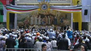 Thousands of worshippers gather in Bethlehem's Manger Square to watch Pope Francis' Mass.