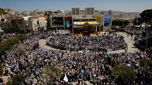 People gather for an open-air Mass led by Pope Francis in Bethlehem's Manger Square.