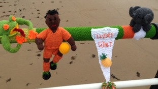 The Ivory Coast player, cheered on by an elephant and a frog.