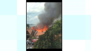 Flames rise above the burning building in the centre of Fakenham