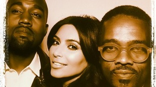 Bridge and groom Kanye West and Kim Kardashian pose with singer Tony Williams.