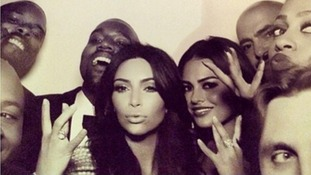 Kanye West Kim Kardashian surrounded by guests in a photo booth at their nuptials.