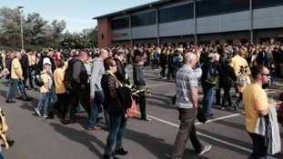 Fans gathered outside the Pirelli Stadium to catch coaches to Wembley