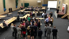 Candidates and supporters await the Wales result