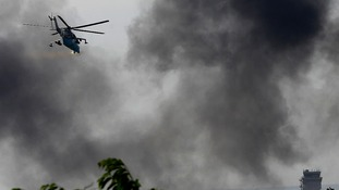 A helicopter flies over Donetsk after scenes of fighting.