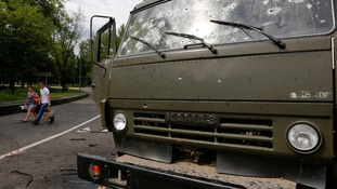 A truck blasted with bullets near Donetsk airport.