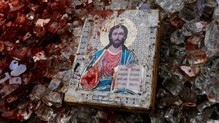 Bloodsatined icon of Jesus seen among items shattered from a Kamaz truck, similar to that used by pro-Russian rebels.