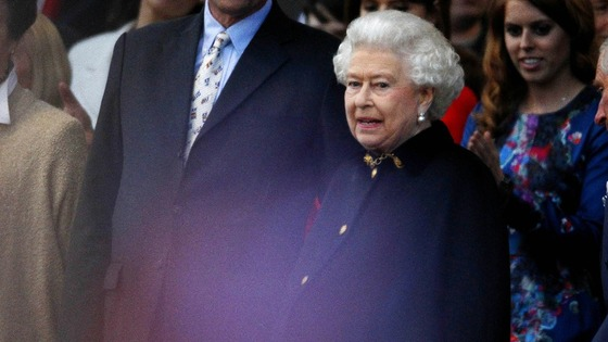 The Queen joins the audience just in time to see Robbie Williams peform