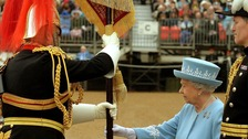 Queen Elizabeth II at Horse Guards Parade, London, as she presents the Household Cavalry with new standards.