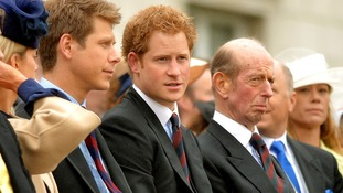Prince Harry (centre) with the Duke of Kent (right) watch Queen Elizabeth II as she presents the Household Cavalry.