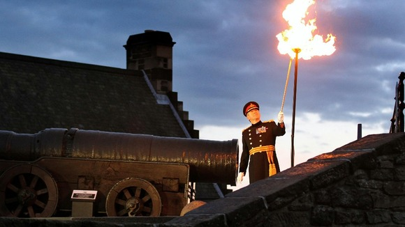 Major General Nick Eeles lights the Diamond Jubilee beacon at Edinburgh Castle