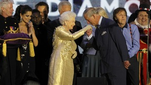 Britain's Queen Elizabeth II has her hand kissed by her son Prince Charles at the end of the Queen's Jubilee Concert i