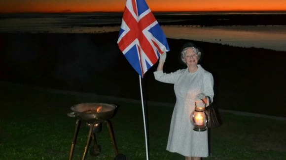 Lynn Moss dressed as Queen Elizabeth ll in Cape