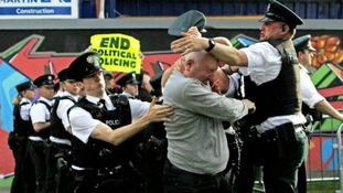 Dissident Republicans tussle with PSNI Officers near the Peace Bridge in Derry City