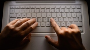 Fingers on a keyboard.