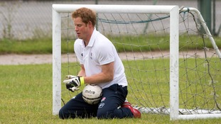 Prince Harry enjoyed a game of football with young children in Suffolk yesterday.
