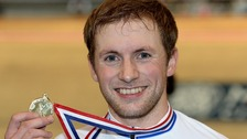 Jason Kenny with his gold medal smiling to camera