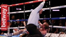 George Groves is counted out by the referee after being knocked down by Carl Froch