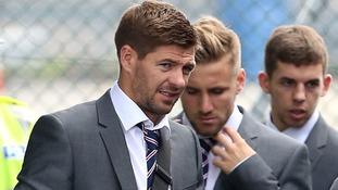 England captain Steven Gerrard arrives at Luton Aitport with his teammates.