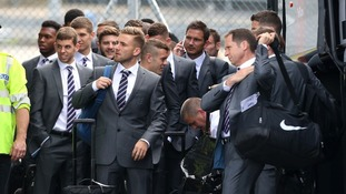 Frank Lampard takes a cheeky phone call as the England squad readies to board the flight to Miami.